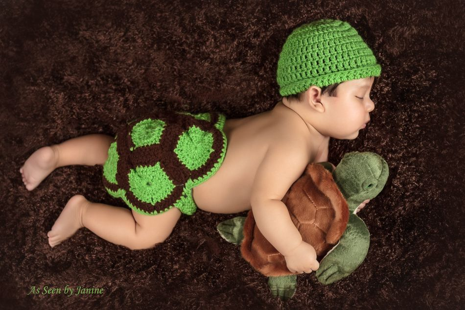 Ian in Turtle Suit Sleeping with Stuffed Turtle Brown Vignette.jpg