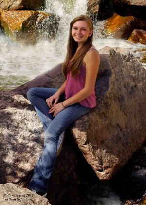 Holly High School Senior Portrait Sitting on Rocks in Creek