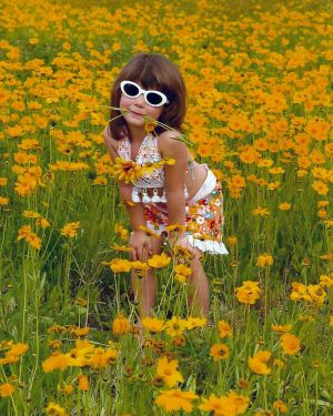 Allie the Daisy Girl Toddler Portrait in Daisy Field