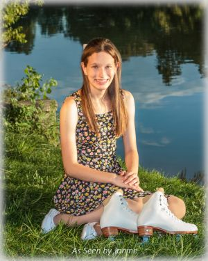 Bobbie Lance with Figure Skates Sitting by Lake.jpg