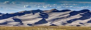Great Sand Dunes and Puffy Clouds in Late Day Light