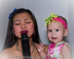 Mommy Singing to Jordan First Birthday (1 of 1).JPG